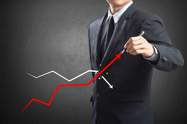 Businessman drawing a growth graph